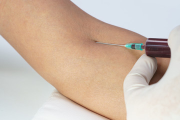 Doctor pricking needle syringe to collect blood for test the health Close up shot. Medical concept