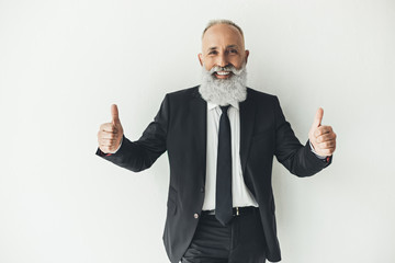 happy senior businessman showing thumbs up on white background