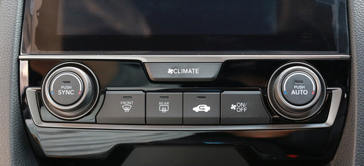 Close up shot of luxury car audio controls.