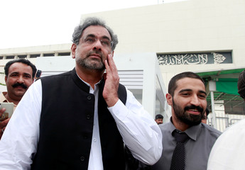 Pakistan's former Petroleum Minister and Prime Minister designate Shahid Khaqan Abbasi leaves after submitting his nomination papers to become the new Premier at the Parliament House in Islamabad