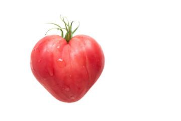 Heart shaped tomato on white background
