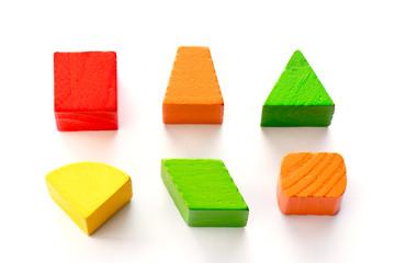 Set of wood shape toy block (square, triangle, trapezoid, oval) on white background