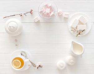 Tea with lemon, macaroon and marshmellow, textspace