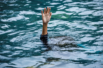 Drowning people raise hands for help in the pool. Fototapete