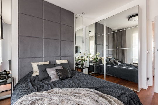Luxurious bedroom with mirrored wardrobe