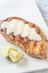 Grilled turkey breast with sauce and lime slice