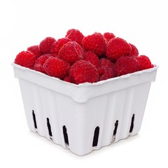 Fresh raspberries in a white paper carton isolated on a white background