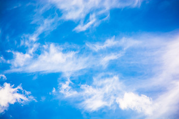 Blue sky with fluffy clouds