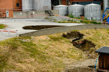 A sinkhole in front of Domsjo Fabriker is seen after a drainage pipe broke, which forced closure of the factory for the day, in Ornskoldsvik