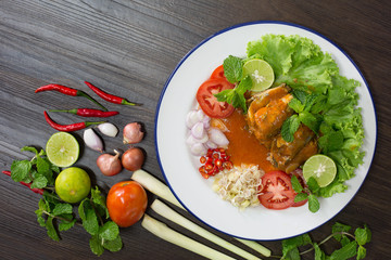 Spicy fish Canned Sardines Salad and ingredient cooking on dark background Thai food