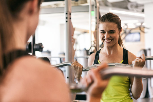 Workspace: Smiling Woman Works Out In Office Fitness Center