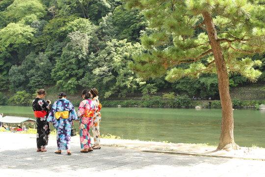 three women in traditionnal japanese kimono, geisha