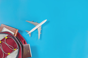 Toy plane is flying out of a travel backpacker bag.