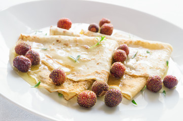 dessert crepes with garden berries and herbs