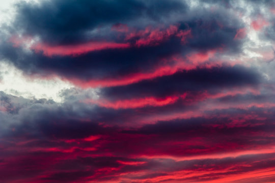 mysterious fiery sky with altocumulus clouds at sunset