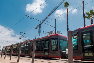 Low angle view of a tram passing near a construction site against sky - Casablanca - Morocco