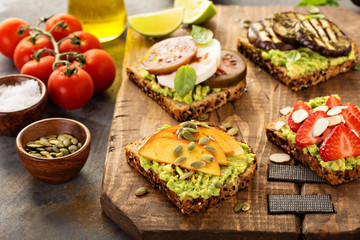 Variety of avocado toasts on a cutting board