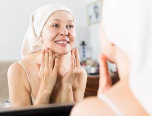 Woman using face cream