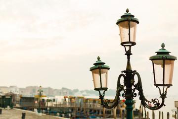 Coast with streetlights, blue sky background in Venice