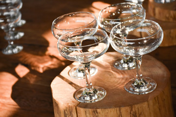 Empty wine glasses on a wooden table or surface
