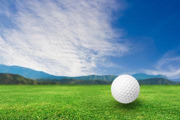 Golf ball on grass nature background