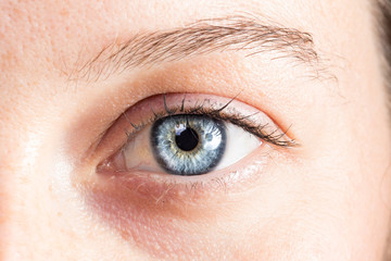 Light blue eye of young girl