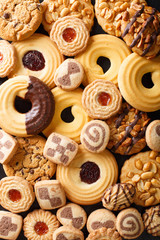 Photo sur Toile Biscuit Background of cookies assorted close-up. Vertical top view