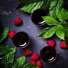 Raspberry drink, black background, top view