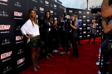 """Cast member Berry poses at a premiere for """"Kidnap"""" in Los Angeles"""