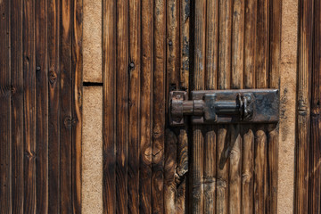 Vintage lock on old wooden door