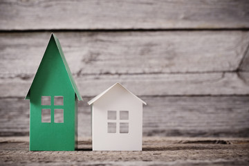 paper house on wooden background