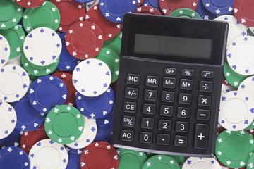 Calculator among gambling chips