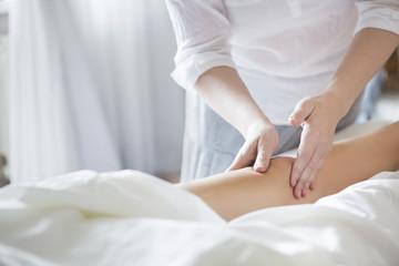Foot massage treatment in asian spa salon