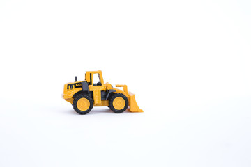Yellow front loader truck isolate on white background, plastic toy