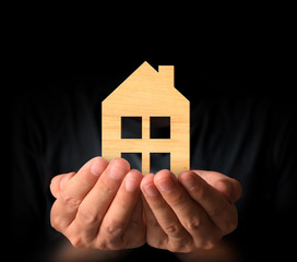 Mortgage concept by house from  hand