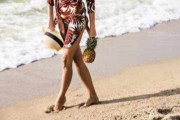 Exotic holiday vacation woman with pineapple