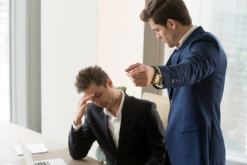 Angry boss dismissing frustrated upset male subordinate, dissatisfied employer telling employee to get out pointing with finger, fired from job, sad manager losing work and becoming jobless, laid off