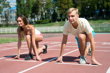 sport couple start competition running at arena track
