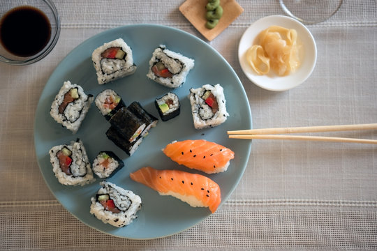 Blue Plate with Traditional Japanese Food: Sushi and Nigiri