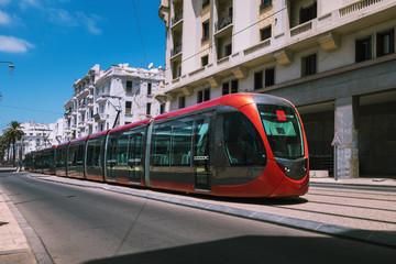 a tram passing on railways between old buildings - Casablanca - Morocco