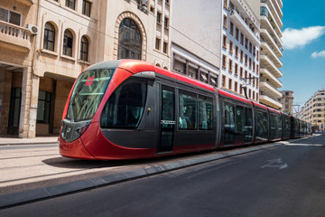 a tram passing on railways between old buildings - Casablanca - Morocco