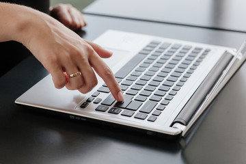 Hands of a beautiful girl on laptop, notebook