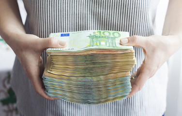 big stack of money in hands, concept for business investment