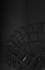 Bent wire-frame structure in the dark. Vertical 3d