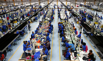 Kenyan workers prepare men's underwear at the Hela intimates export processing zone limited factory in Athi River, near Nairobi