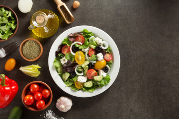fresh greek salad in plate and ingredients