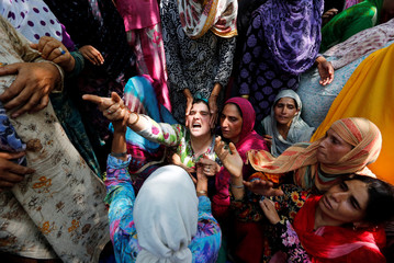Relatives wail during the funeral of Firdous Ahmad, a civilian, who according to local media was killed during clashes following the killing of two militants in a gunbattle with Indian security forces, at Begumbagh