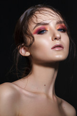 Portrait of beautiful young model with professional makeup, perfect skin, wet hairdo. Trendy colorful smoky eyes.