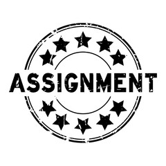 Grunge black assignment wording with star icon round rubber seal stamp on white background