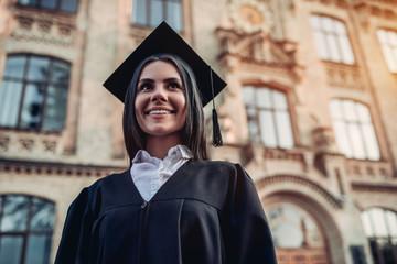 Female graduate near university